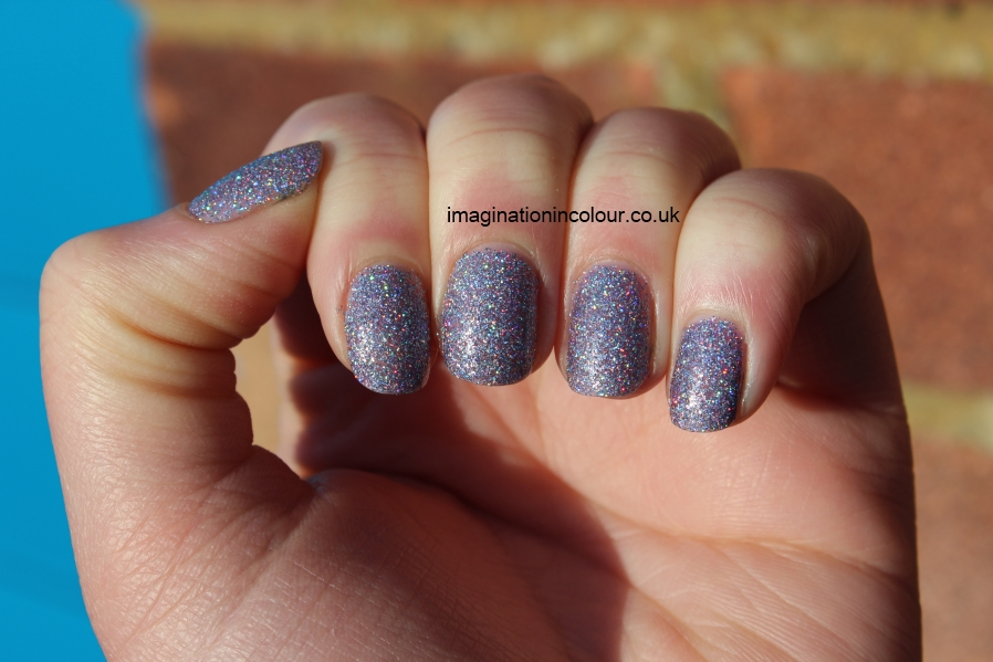 Models Own Southern Lights purple lilac scattered holo holographic glitter multicoloured sparkle juicy jules northern wonderland collection topcoat winter 2012 review blog UK nail polish swatch (2)